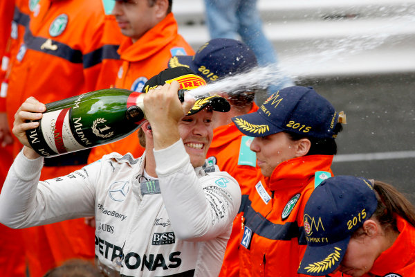 Monte Carlo, Monaco. Sunday 24 May 2015. Nico Rosberg, Mercedes AMG, 1st Position, sprays the victory Champagne. World Copyright: Glenn Dunbar/LAT Photographic. ref: Digital Image _W2Q2615
