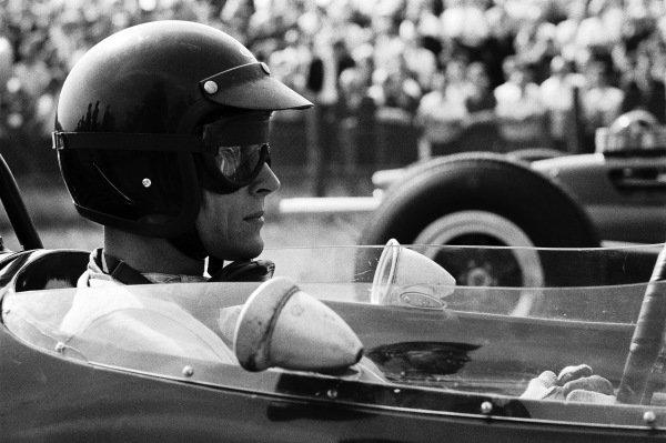 Dan Gurney, Brabham BT7 Climax, prepares for the start.