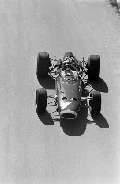 Jackie Stewart, BRM P261, corrects a slide.