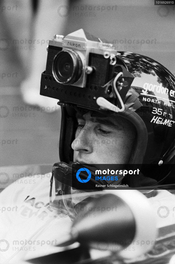 Jackie Stewart wearing an improvised helmet camera.