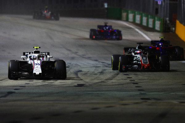Sergey Sirotkin, Williams FW41, leads Romain Grosjean, Haas F1 Team VF-18, Pierre Gasly, Scuderia Toro Rosso STR13, and Brendon Hartley, Toro Rosso STR13 Honda