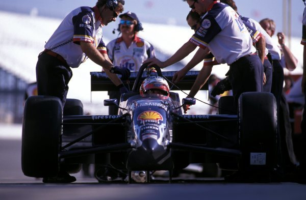 Adjustments are made to the car of Max Papis (ITA) Team Rahal in the pits.Fedex Champ Car World Series, Rd12, Michigan, USA, 25 July 1999.BEST IMAGE