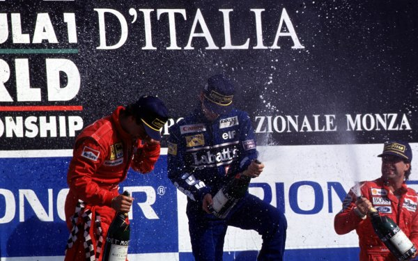 1993 Italian Grand Prix.Monza, Italy.10-12 September 1993.Damon Hill (Williams Renault), Jean Alesi (Ferrari) and Michael Andretti (McLaren Ford) celebrate finishing in 1st, 2nd and 3rd positions respectively.World Copyright - LAT Photographic
