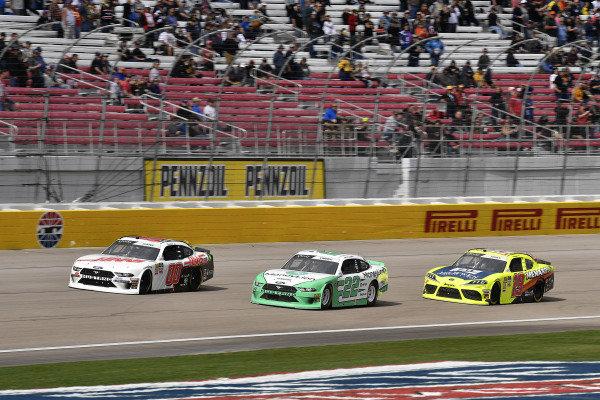#00: Cole Custer, Stewart-Haas Racing, Ford Mustang Haas Automation, #22: Austin Cindric, Team Penske, Ford Mustang MoneyLion, and #19: Brandon Jones, Joe Gibbs Racing, Toyota Supra Menards/Jeld-Wen