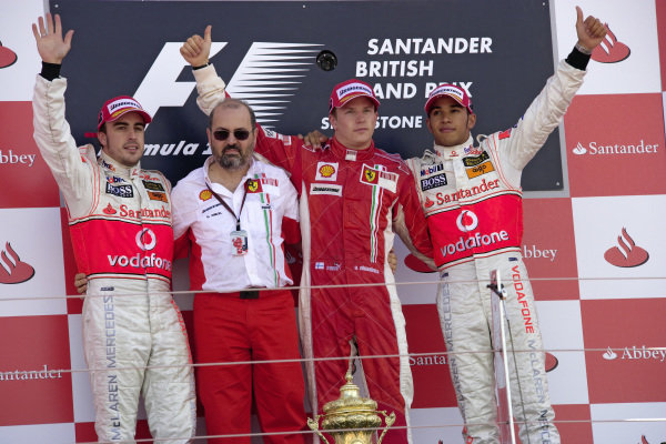 Podium group photo: Fernando Alonso, 2nd position, Ferrari's Head of Engine Design Gilles Simon, winner Kimi Räikkönen and Lewis Hamilton, 3rd position.
