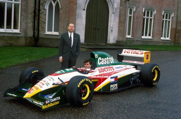 Alex Zanardi (ITA) with Peter Collins (AUS) at the launch of the new Lotus 107C Mugen-Honda. Lotus 107C Mugen-Honda Launch, Ketteringham Hall, Norfolk, England, 7 December 1993.