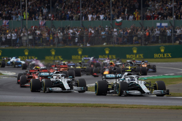 Valtteri Bottas, Mercedes AMG W10, leads Lewis Hamilton, Mercedes AMG F1 W10, Charles Leclerc, Ferrari SF90, Max Verstappen, Red Bull Racing RB15, Sebastian Vettel, Ferrari SF90, Pierre Gasly, Red Bull Racing RB15, and the rest of the field at the start