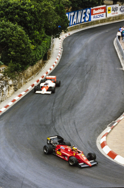 Michele Alboreto, Ferrari 156/85, leads Alain Prost, McLaren MP4-2B TAG.