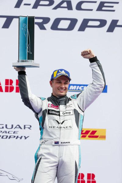 Simon Evans (NZL), Team Asia New Zealand, 3rd position, celebrates on the podium