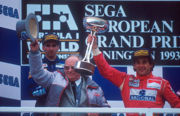 1993 European Grand Prix. Donington Park, England. 9-11 April 1993. Ayrton Senna (McLaren Ford) 1st position and Damon Hill (Williams Renault) 2nd position on the podium. Circuit owner Tom Wheatcroft also stands on the podium. Ref-93 EUR 01. World Copyright - LAT Photographic