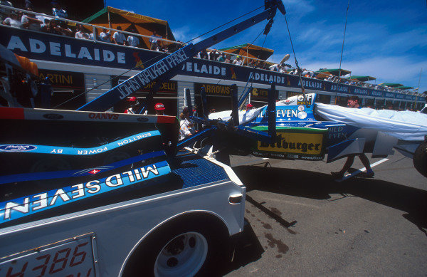 1994 Australian Grand Prix.Adelaide, Australia.11-13 November 1994.Michael Schumacher's damaged Benetton B194 Ford is brought back to the pits.Ref-94 AUS 07.World Copyright - LAT Photographic