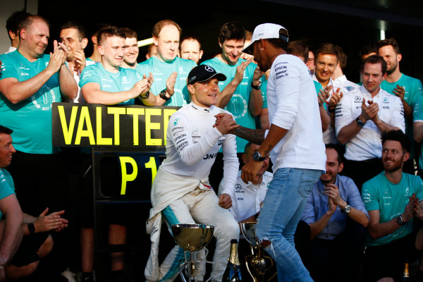 Sochi Autodrom, Sochi, Russia. Sunday 30 April 2017. Valtteri Bottas, Mercedes AMG, is congratulated on his victory by Lewis Hamilton, Mercedes AMG, as colleagues applaud. World Copyright: Andy Hone/LAT Images ref: Digital Image _ONZ2496
