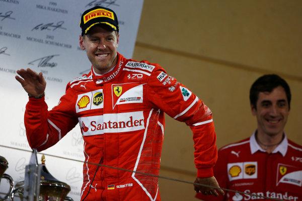 Bahrain International Circuit, Sakhir, Bahrain.  Sunday 16 April 2017. Sebastian Vettel, Ferrari, 1st Position, celebrates as he arrives on the podium. World Copyright: Andrew Hone/LAT Images ref: Digital Image _ONZ0258