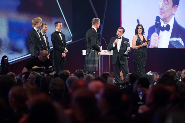 2017 Autosport Awards Grosvenor House Hotel, Park Lane, London. Sunday 3 December 2017. WEC Champions Brendon Hartley, Timo Bernhard and Earl Bamber present the John Bolster award to Pierre Fillon on behalf of the Automobile Club de l'Ouest. World Copyright: Zak Mauger/LAT Images  ref: Digital Image _O3I7334