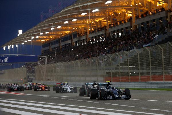 Bahrain International Circuit, Sakhir, Bahrain. Sunday 3 April 2016. Nico Rosberg, Mercedes F1 W07 Hybrid leads Lewis Hamilton, Mercedes F1 W07 Hybrid at the start of the race. World Copyright: Glenn Dunbar/LAT Photographic ref: Digital Image _W2Q6247