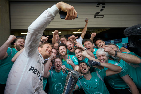 Shanghai International Circuit, Shanghai, China. Sunday 17 April 2016. Nico Rosberg, Mercedes AMG, 1st Position, and the Mercedes team celebrate victory after the race. World Copyright: Steve Etherington/LAT Photographic ref: Digital Image SNE22070