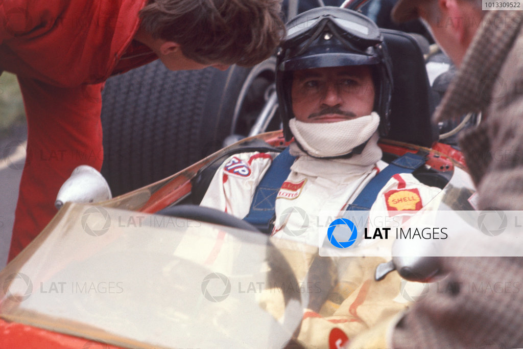 Graham Hill sits in his Lotus before the race. Portrait.