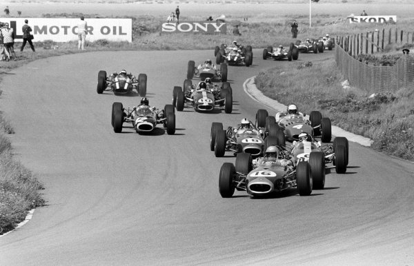 Pole sitter and race winner Jack Brabham (AUS) Brabham BT19 leads the field at the start of the race.  Dutch Grand Prix, Zandvoort, 24 July 1966.