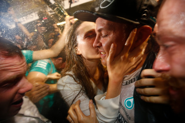 Yas Marina Circuit, Abu Dhabi, United Arab Emirates. Sunday 27 November 2016. Nico Rosberg, Mercedes AMG, 2nd Position, receives a kiss from his wife after securing the World Drivers Championship. World Copyright: Andrew Hone/LAT Photographic ref: Digital Image _ONZ0831