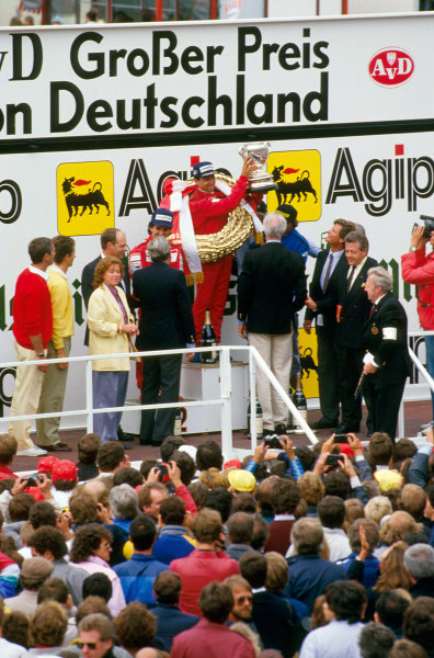 Nurburgring, Germany.2-4 August 1985.Michele Alboreto (Ferrari) 1st position, Alain Prost (McLaren TAG Porsche) 2nd position and Jacques Laffite (Ligier Renault) 3rd position on the podium.Ref-85 GER 06.World Copyright - LAT Photographic