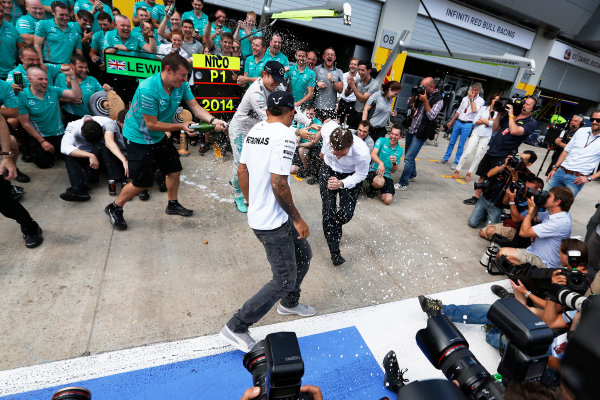 Red Bull Ring, Spielberg, Austria. Sunday 22 June 2014. Nico Rosberg, Mercedes AMG, 1st Position, and Lewis Hamilton, Mercedes AMG, 2nd Position, celebrate victory with their team. World Copyright: Sam Bloxham/LAT Photographic. ref: Digital Image _SBL0495