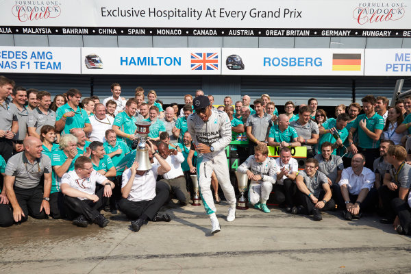 Autodromo Nazionale di Monza, Monza, Italy. Sunday 7 September 2014. Lewis Hamilton, Mercedes AMG, 1st Position, Nico Rosberg, Mercedes AMG, 2nd Position, Toto Wolff, Executive Director (Business), Mercedes AMG, Paddy Lowe, Executive Director (Technical), Mercedes AMG, and the Mercedes AMG team celebrate.  World Copyright: Steve Etherington/LAT Photographic. ref: Digital Image SNE15874