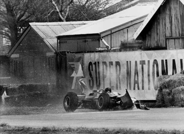 Aintree, England. 18th April 1964.Jim Clark (Lotus 33-Climax), retired, walks away from this high speed crash at the Melling Crossing, action. World Copyright: David Hudson/LAT Photographic.Ref:  DH - 64AIN - Neg24A-25.