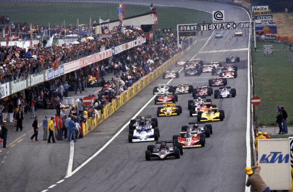 Osterreichring, Zeltweg, Austria. 11-13 August 1978. Ronnie Peterson (Lotus 79 Ford) leads Carlos Reutemann (Ferrari 312T3) Jacques Laffite (Ligier JS9 Matra and Mario Andretti (Lotus 79 Ford) at the start. World Copyright - LAT Photographic Ref: 78AUT16