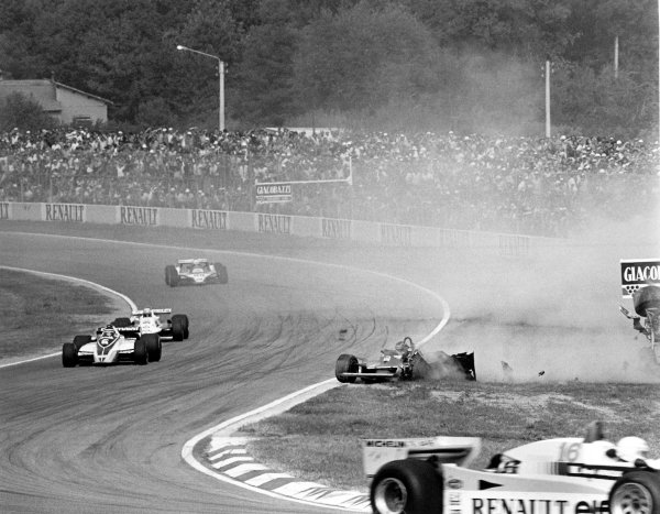 Imola, Italy. 12-14 September 1980.Rene Arnoux (Renault RE20) leads Hector Rebaque (Brabham BT49-Ford Cosworth), Alan Jones (Williams FW07B-Ford Cosworth) and Didier Pironi (Ligier JS11/15-Ford Cosworth) as Gilles Villeneuve (Ferrari 312T5) crashes. Accident.World Copyright: LAT PhotographicRef: 14056/32