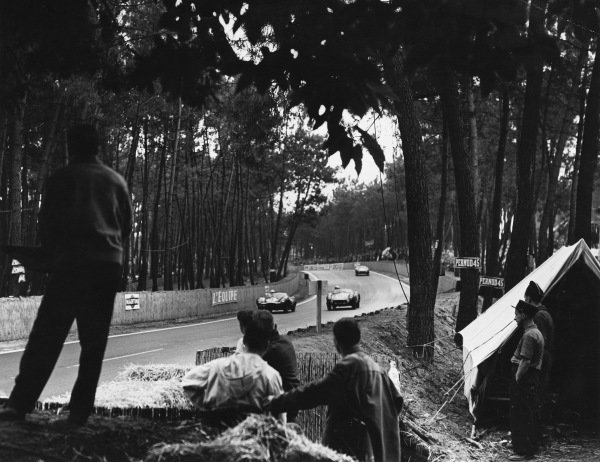 Le Mans, France. 28th - 29th July 1956.Ninian Sanderson/Ron Flockhart (Jaguar D-type), 1st position, leads Stirling Moss/Peter Collins (Aston Martin DB3S), 2nd position, action. World Copyright: LAT Photographic.Ref: B/W Print.
