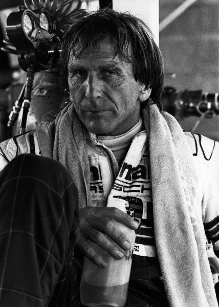 Le Mans, France. 18-19 June 1983.Derek Bell (Porsche 956), 2nd position, in the pits, portrait. World Copyright: LAT Photographic.Ref:  B/W Print.