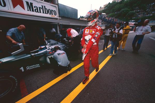 Monte Carlo, Monaco. 13-16 May 1999. Michael Schumacher (Ferrari F399), 1st position, walks through the pits, portrait.  World Copyright: LAT Photographic. Ref:  99 MON 69.