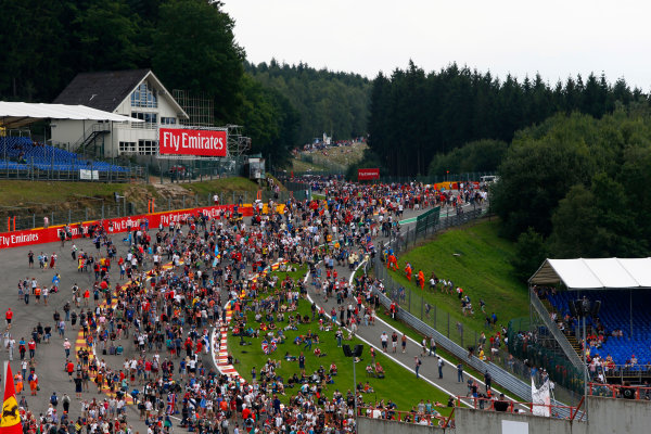 Spa-Francorchamps, Spa, Belgium. Sunday 23 August 2015. Fans invade the circuit after the race. World Copyright: Zak Mauger/LAT Photographic. ref: Digital Image _L0U5518