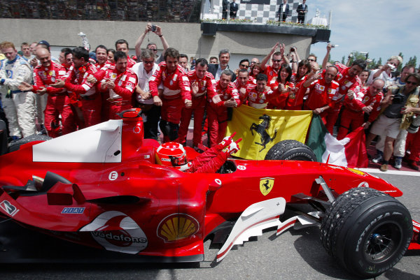 2004 Canadian Grand Prix - Sunday Race,2004 Canadian Grand Prix Montreal, Canada. 13th June 2004 Winner Michael Schumacher, Ferrari F2004 arrives in parc ferme to the cheers of his team. World Copyright: Steve Etherington/LAT Photographic ref: Digital Image Only