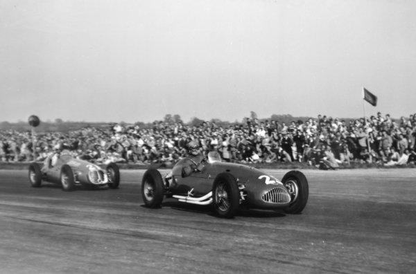 "1950 British Grand Prix.Silverstone, Great Britain. 13 May 1950.Joe Kelly (Alta GP) leads ""B Bira"" (Maserati 4CLT/48). Ref-C26602.World Copyright - LAT Photographic"