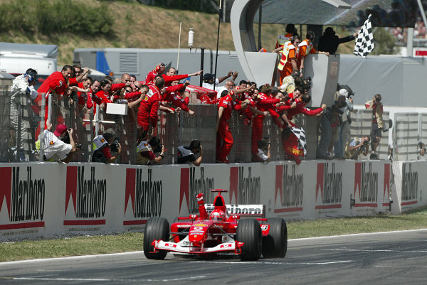 2003 Spanish Grand Prix - Sunday Race,Barcelona, Spain. 4th May 2003 Michael Schumacher, Ferrari F2003 GA, throws his fist into the air to celebrate his win.World Copyright: Steve Etherington/LAT Photographic ref: Digital Image Only