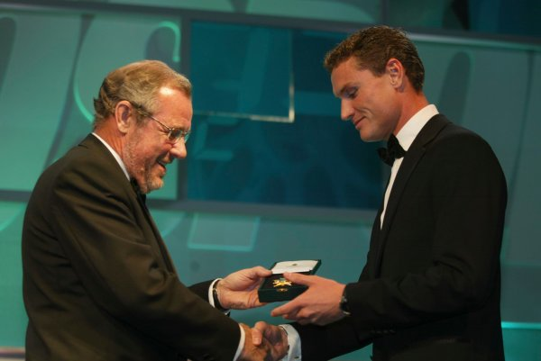 2003 AUTOSPORT AWARDS, The Grosvenor, London. 7th December 2003.David Coulthard receives a Gold award from the BRDC presented by Richard Caborn, Minister for Sport.Photo: Peter Spinney/LAT PhotographicRef: Digital Image only