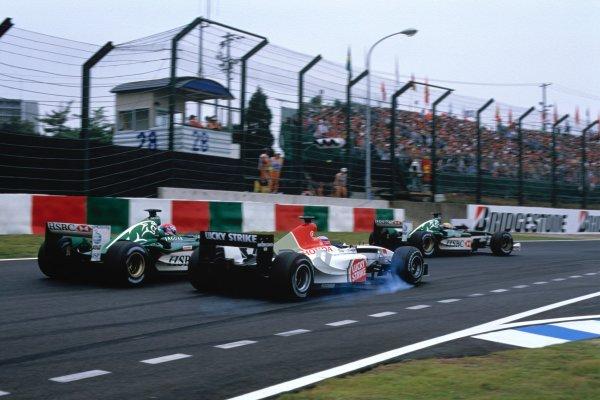 2003 Japanese Grand PrixSuzuka, Japan. 10th - 112th October 2003.Takuma Sato, BAR Honda 005, overtakes Justin Wilson, Jaguar R4, action.World Copyright: Steven Tee / LAT Photographic ref: 35mm Image 03JAP21