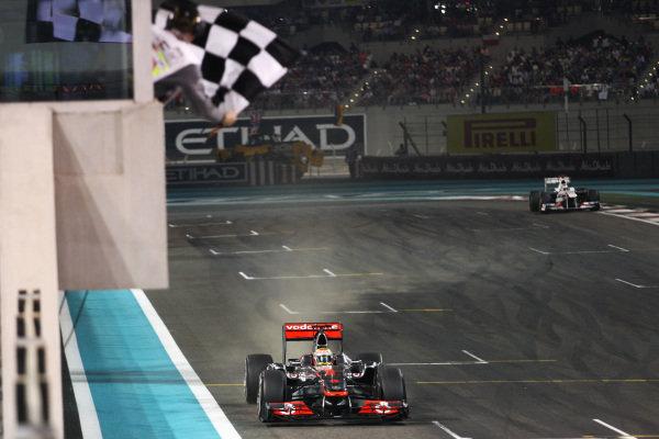 Race winner Lewis Hamilton (GBR) McLaren MP4/26 takes the chequered flag at the end of the race. Formula One World Championship, Rd 18, Abu Dhabi Grand Prix, Race, Yas Marina Circuit, Abu Dhabi, UAE, Sunday 13 November 2011. BEST IMAGE