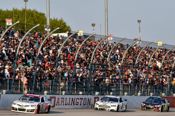 11-12 April, 2014, Darlington, South Carolina USA Denny Hamlin, Sport Clips Toyota Camry and Brad Keselowski © 2014, Nigel Kinrade LAT Photo USA