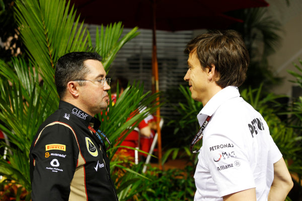 Marina Bay Circuit, Singapore. Friday 20th September 2013. Eric Boullier, Team Principal, Lotus F1 talks with Toto Wolff, Executive Director, Mercedes AMG in the paddock. World Copyright: Charles Coates/LAT Photographic. ref: Digital Image _N7T2961