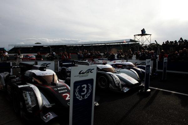 Silverstone, England. 24th - 26th August 2012. Rd 4.the cars of Tom Kristensen (DNK), Allan McNish (GBR), Audi Sport Team Joest, Audi R18 Ultra, Andre Lotterer (GER), Marcel Fassler (CHE), Benoit Treluyer (FRA), Audi Sport Team Joest, Audi R18 E-Tron Quatrro, Alexander Wurz (AUT), Nicolas Lapierre (FRA), Kazuki Nakajima (JPN), Toyota Racing, Toyota TS030 Hybrid, in Parc Ferme, portrait, atmosphere, World Copyright: Chris Bird/LAT Photographic.Ref:  _A1A0903
