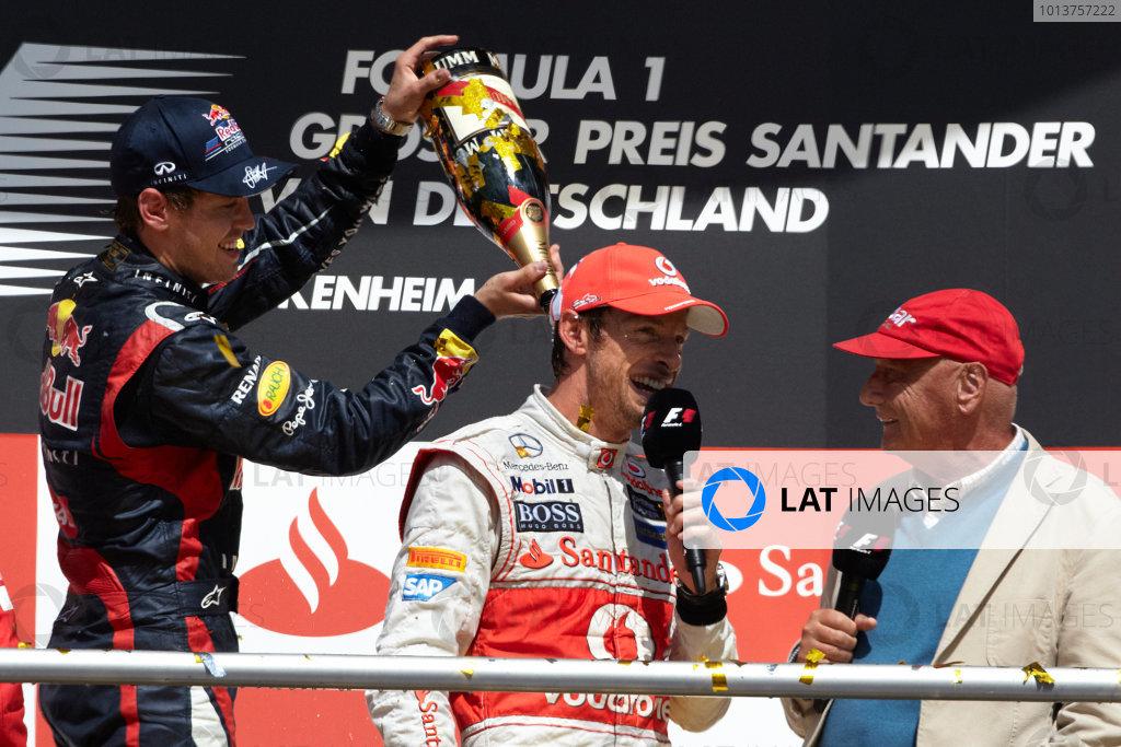 Hockenheimring, Hockenheim, Germany 22nd July 2012 Sebastian Vettel, Red Bull Racing, 2nd position, gives Jenson Button, McLaren MP4-27  a soaking on the podium with Niki Lauda. World Copyright: Steve Etherington/LAT Photographic ref: Digital Image HC5C6012 copy