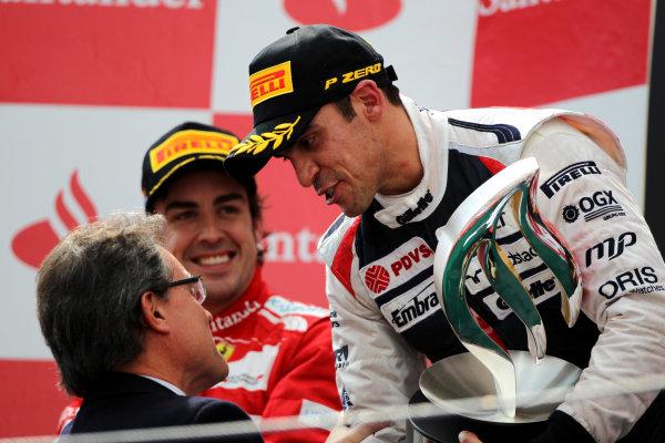 Circuit de Catalunya, Barcelona, Spain13th May 2012Pastor Maldonado, Williams F1 Team, 1st position, receives his trophy on the podium.World Copyright: Andy Hone/LAT Photographicref: Digital Image HONY9243