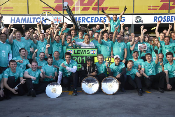 Albert Park, Melbourne, Australia. Sunday 15 March 2015. Lewis Hamilton, Mercedes AMG and Nico Rosberg, Mercedes AMG celebrate with their team after winning the race. World Copyright: Steve Etherington/LAT Photographic. ref: Digital Image SNE21610
