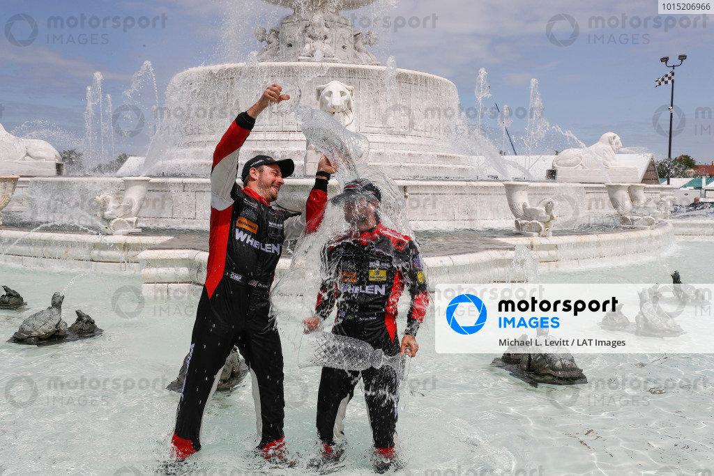 #31 Action Express Racing Cadillac DPi, P: Eric Curran, Felipe Nasr celebrate in the scott fountain