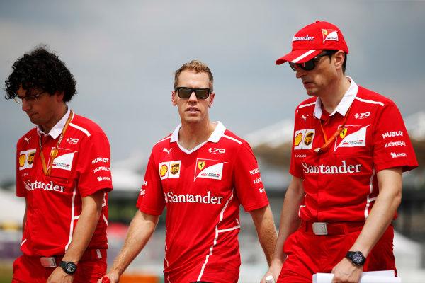Sepang International Circuit, Sepang, Malaysia. Thursday 28 September 2017. Sebastian Vettel, Ferrari, conducts a track walk with colleagues. World Copyright: Zak Mauger/LAT Images  ref: Digital Image _X0W6707