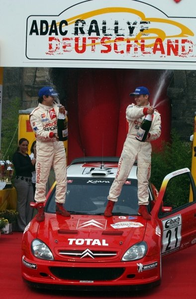 Rallye Deutschland winners Daniel Elena (FRA), left, and Sebastien Loeb (FRA), Citroen,  spray the victory champagne.
