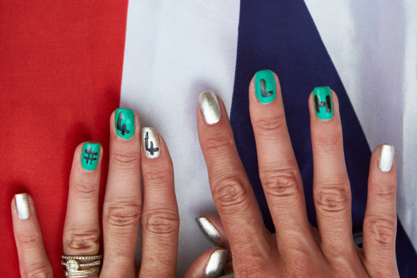 Silverstone Circuit, Northamptonshire, England. Saturday 4 July 2015. A Lewis Hamilton fan with painted nails. World Copyright: Steve Etherington/LAT Photographic ref: Digital Image SNE19065