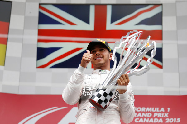 Circuit Gilles Villeneuve, Montreal, Canada. Sunday 7 June 2015. Lewis Hamilton, Mercedes AMG, 1st Position, with his trophy. World Copyright: Steven Tee/LAT Photographic. ref: Digital Image _X0W6835